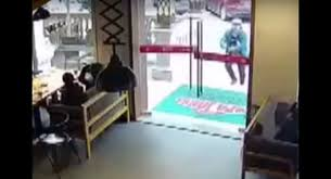 deliveryman smashes through glass door
