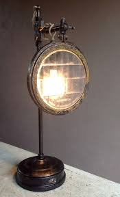 headlamp lens table lamp crafted of parts and vintage auto headlamp lens sold in