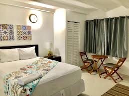 a bed or beds in a room at la posada walking beach apartments