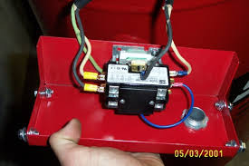 got a new air compressor but i need some help wiring it up the white black and green wire are from the motor the 3 wires on the left of the pic the white and black go into one side of the relay and the green