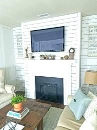 comfortable tv on mantle hide wires