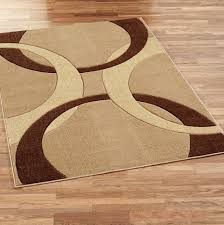 brown and tan area rugs