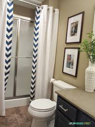 Guest bathroom makeover with chevron DIY shower curtain and navy sink.