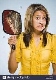 woman holding hand mirror. Woman Holding Broken Hand Held Mirror G