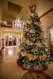 Incredible winter living room design ideas for holiday spirit Christmas Tree Over The Top Christmas Trees Getty Images Elle Decor Stunning Christmas Tree Ideas For 2018 Best Christmas Tree