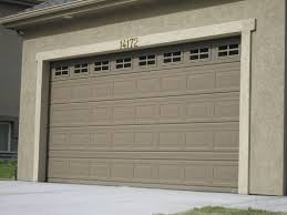 almond garage doorGarage door style to match front door windows Maybe in light