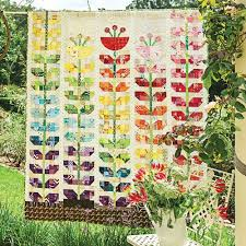 garden quilt. Styled Shot Of Patchwork And Appliqué Sprouting Flowers Quilt Hanging Up In Garden