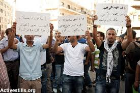 photo essay palestinians protest high prices i economic  palestinians block traffic in ramallah s busy al manara square on 4 2012 protesting the high cost of living and calling for the resignation of