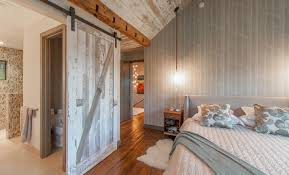 bedroom sliding barn door and birch tree wallpaper