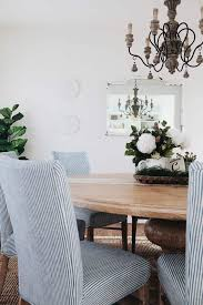 french country dining room in white with natural wood blue and white striped chairs