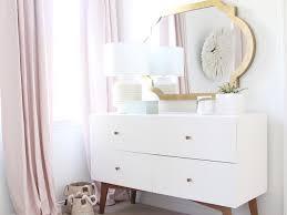 fabulous nursery features a gold leaf mirror surya richmond mirror over a white mid century modern dresser west elm modern 6 drawer dresser