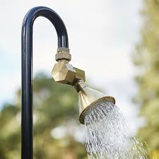 sy brass fittings bespeak of permanency but a clever design allows this stylish outdoor shower to convert to a foot bath on an instant s notice