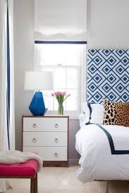 picture of blue and white bedroom with gray walls blue lamp blue and white curtains