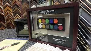 non glare vs reg vs conservation glass