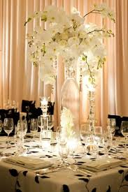 hanging crystals for wedding centerpieces. glass vase with white orchids and roses hanging crystals; black wedding crystals for centerpieces