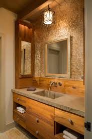 pendant modern bathroom lighting above single sink bathroom vanity and large mirror