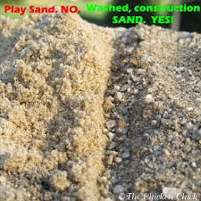 grade sand is used for en coops and runs not play sand