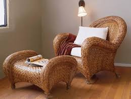 Rattan Woven And Wrapped Around This Ottomanu0027s Dramatically Shaped Frame  Echoes The Curves Of Its Matching Chair Pottery Barn Rattan Chair K49