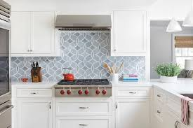 gray mosaic glass tile backsplash with white cabinets