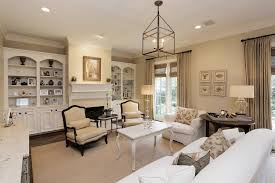 living room and window treatments built in bookshelves and cabinets french windows and doors living