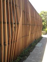 wood slat wall. Wood Slat Walls With Glass Behind Under Roof Overhang To Office Entrances On West Side Wall I