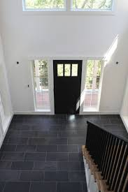 White walls black door and tile floor all thats needed is a
