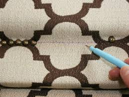 draw line on fabric to guide nailhead placement