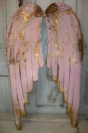 gold and pink angel wings wall art