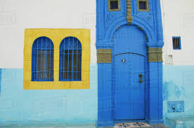 blue door house. A Painted Blue Door And Bright Yellow Window Frame On House In Old Town;Rabat Morocco