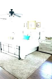 area rug under bed rugs underneath master bedroom placement queen size dimensions