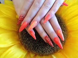Stiletto Nails With Orange Gel Polish and Zebra Print Nail Art ...