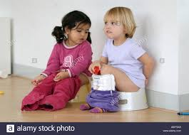 Two Toddler Girls Using A Potty Stock Photo 3110312 Alamy