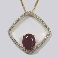 14 karat gold ruby and diamond pendant
