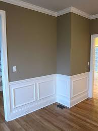 interior shadow box wall moldings and chair rail trim in a custom dream home pottery barn wall color with white trim and crown molding built by advane