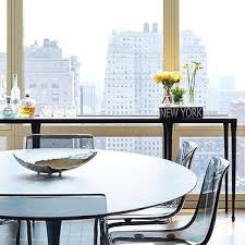 oval marble top dining table with black ikea ghost chairs