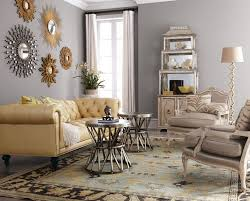 silvery gray and a collection of sunburst mirrors give this room a polished  demeanor