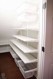 ikea algot shelves in a closet under the stairs