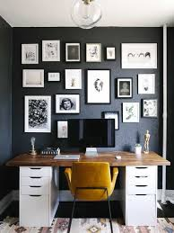 home office wall ideas. Inspiration For A Mid-sized Scandinavian Freestanding Desk Study Room Remodel In Boston With Black Home Office Wall Ideas O