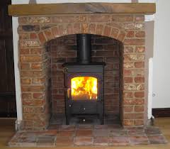 clearview pioneer wood burning stove with brick arch and beam nice stove great surround
