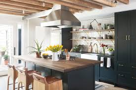 new york butcher block countertop kitchen transitional with open shelves bar stools and counter black shaker cabinets