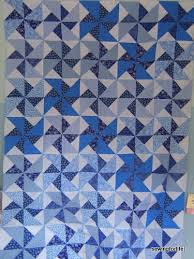 The 16 Patch Double Pinwheel Project – Auditioning an Inner Border ... & And today! I have this up on the wall auditioning some blue inner border  fabrics. I stopped off at a quilt shop yesterday thinking I needed to get a  dark ... Adamdwight.com