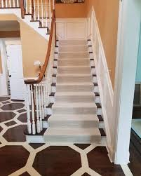 the bold patterns of this wood floor work nicely with the subtle texture driven motif of this runner