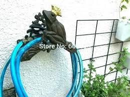 hose holder ll mount mounted vintage cast iron decorative washing machine drain garden stake hose holder garden