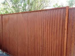 metal fence with rust finish corrugated metal gate