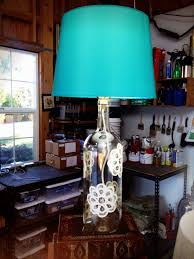 lamp a socket with a switch drill press and the bulb you can also have a wooden block to use as a stand to hold the wine bottle if need be