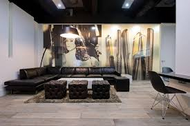 brown leather chairs for office reception area with unique wall art and brown rugs above wooden flooring design ideas