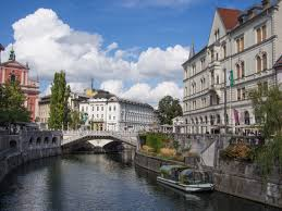 ljubljana photo essay the prettiest capital in europe ljubljana river and triple bridge