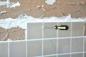 remove tile from concrete floor after l and stick