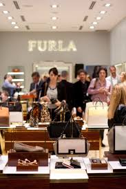 furla relaunch at village of merrick park the architect of style