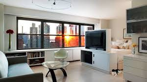 studio living room furniture. Amazing City View From Modern Studio Apartment Ideas With Glass Top Table And Grey Sofa Living Room Furniture O